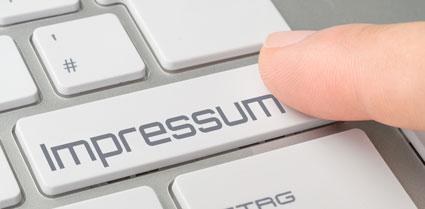 Impressum Taste auf Tastatur
